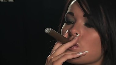 The legendary and oh so beautiful Charley Atwell blowing hot cigar smoke!