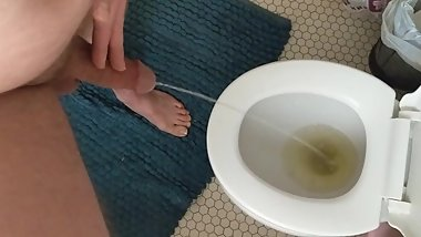 Struggling to pee with half hard cock after hot masturbation session
