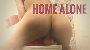 Round ass babe rides dildo in bathroom