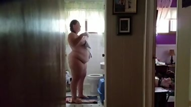 Ugly wife shows her 249 pound nude body in the bathroom at home