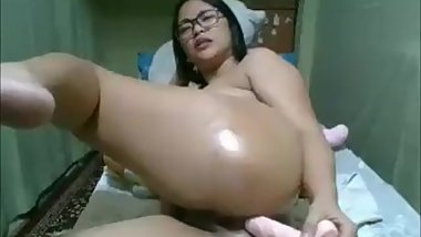 pinay rocyl plays her butt hole with a big dildo