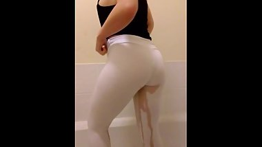 Long stream of pee in white leggings