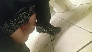 Naughty piss all over the floor in a busy public restroom