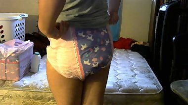 Cute Trans girl changes into diaper