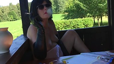 Smoking in leather opera gloves and pink panties