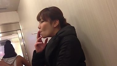 Sexy Japanese girl quickly hammers down smokes 2 cigs in 3.5min