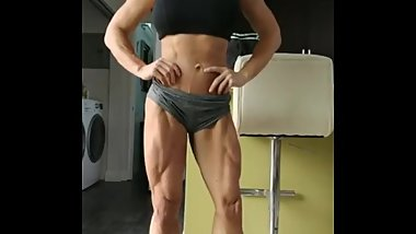 Muscle Girl Flexes Ripped Legs
