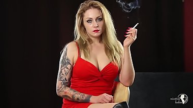 A hot blonde girl smokes a cigarette. Hot body and sexy big tits! Amazing!