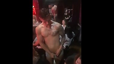 Male dancer entertaining sexy ladies at a club