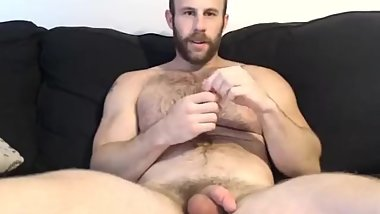 Handsome bearded guy performing on cam.