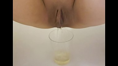 Peeing/pissing in the cup of glass