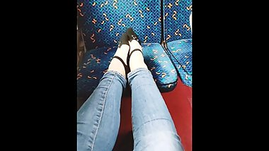My little sister plays with her feet in the train. Public foot fetish